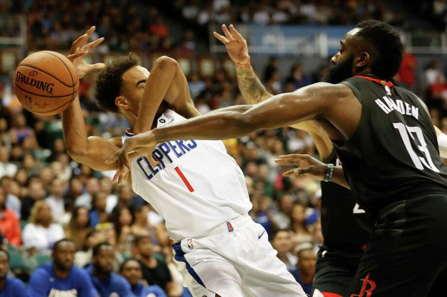 Houston Rockets shooting guard James Harden (13), knocks the ball away from Los Angeles Clippers shooting guard Jerome Robinson (1) during the third quarter of an NBA preseason basketball game against the Los Angeles Clippers, Thursday, Oct 3, 2019, in Honolulu. (AP Photo/Marco Garcia) Photo: Marco Garcia, Associated Press / 2018 Copyright the Associated Press. All Rights Reserved.