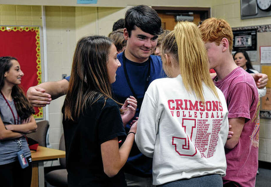 "Students at Jacksonville High School form groups Thursday during a game called ""Left Out,"" which showcases the impact of stereotyping and the formation of cliques. Photo: Samantha McDaniel-Ogletree 