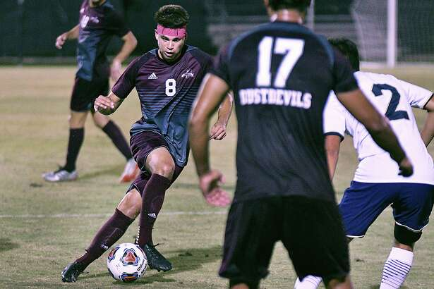 Midfielder David Martinez controls the ball for the TAMIU Dustdevils as they played St. Edward's University Thursday, October 3, 2019 at the TAMIU Soccer Field.