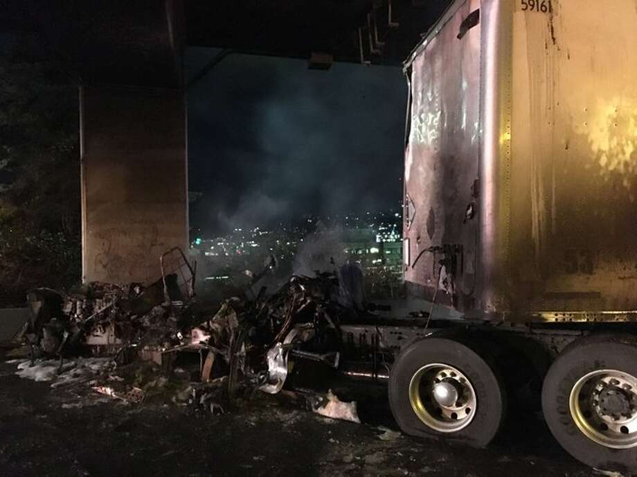 The Interstate 5 express lanes were closed Friday morning after a tractor-trailer crashed and caught fire near Mercer Street just before 6 a.m. The lanes were not expected to reopen during the morning commute. Photo: Courtesy WSP