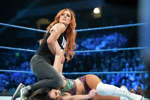 WWE superstar Becky Lynch, at left shown wrestling Peyton Royce, will feature in the first Friday Night SmackDown show on Fox, on Oct. 4, 2019.