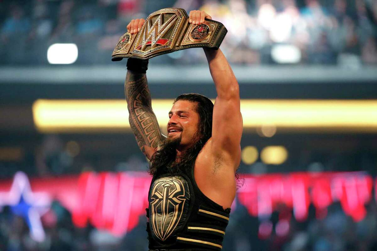 In this April 3, 2016, file photo, Roman Reigns holds up the championship belt after defeating Triple H during WrestleMania 32 at AT&T Stadium in Arlington, Texas. Reigns will feature in the first Friday Night SmackDown show on Fox, on Oct. 4, 2019.