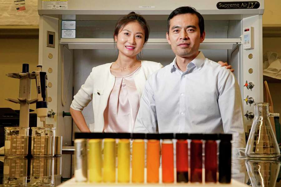 Faye Liu, RevoChem founder and CEO, and her husband, Jiang Wu, co-founder, are shown in their lab at the University of Houston Technology Bridge Tuesday, Sept. 17, 2019, in Houston. Displayed are samples of crude oil taken from different well heads in the Permian Basin. RevoChem analyzes geochemical fingerprints in oil and rock formations.