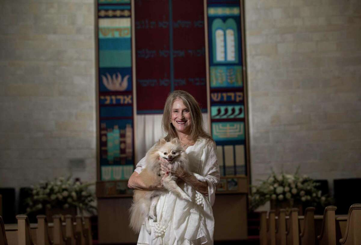 Mirl Cohen and her dog Sammie pose for a portrait in the sanctuary at Brith Shalom on Wednesday, Oct. 2, 2019, in Houston.