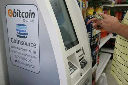 A customer uses a Bitcoin ATM at Diamond Food Mart on Callaghan Road on Oct. 3, 2019.