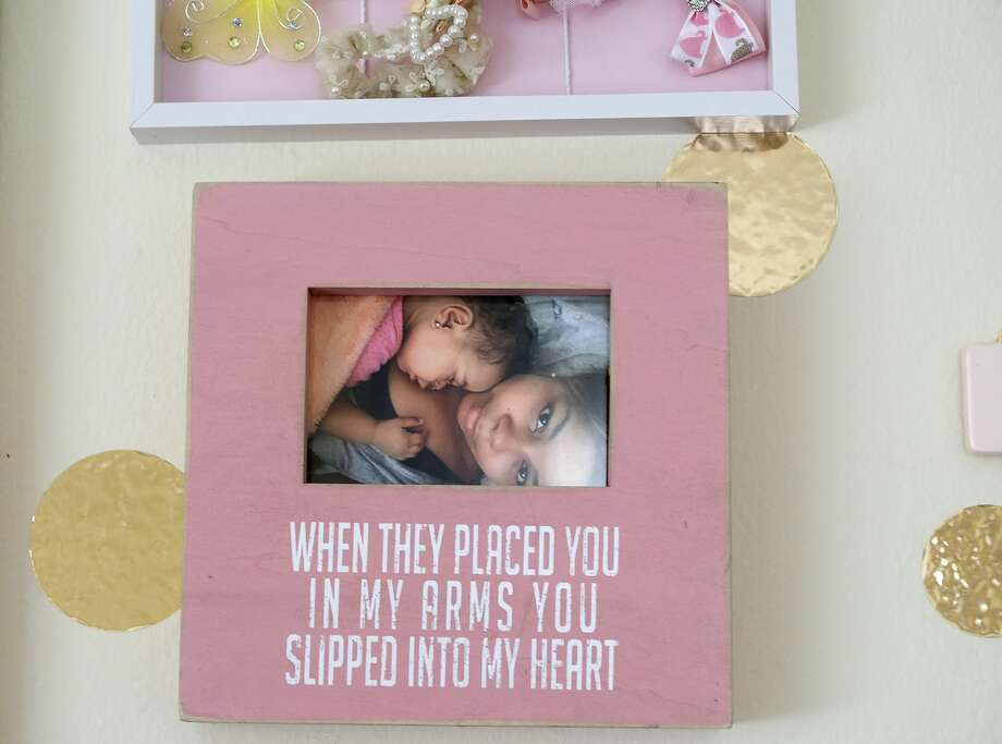 A photo of Ajshay and Harper hangs in the little girl's room. Photo: Elizabeth Conley/Staff Photographer