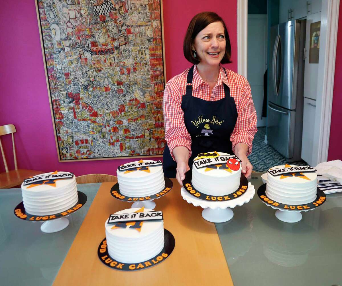 """Janet Roush Flood finishes up decorating her """"good luck cakes"""" for several of the Astros players. She started making the cakes for her neighbor Marwin González. Then came Altuve and the rest of the team."""