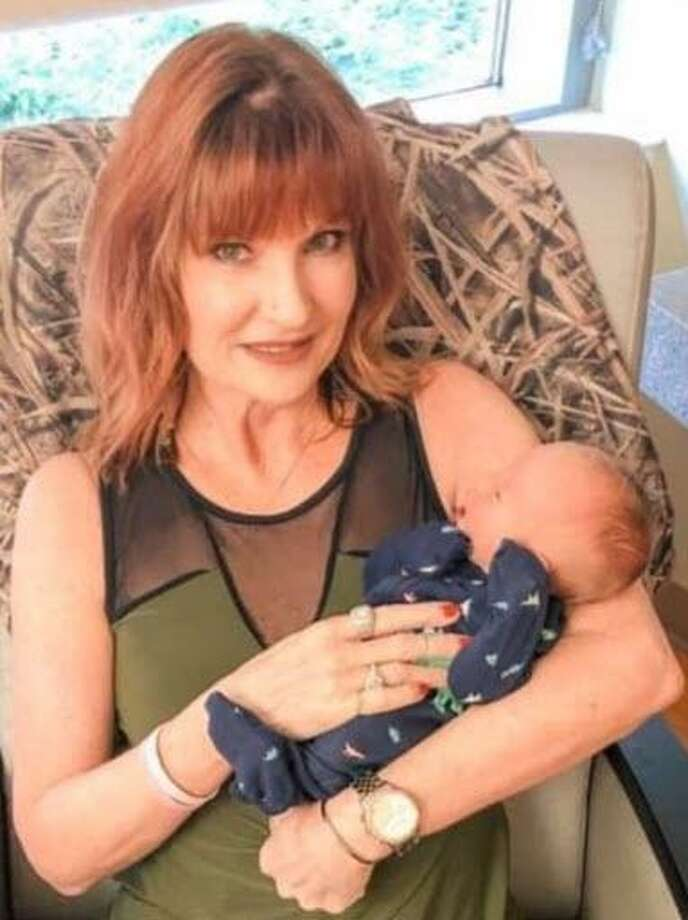 Mitsy Stumpf of Kingwood is a breast-cancer survivor and a grandmother for the first time. She holds her grandson Samuel. Photo: Courtesy Mitsy Stumpf / Courtesy Mitsy Stumpf