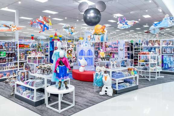 """Mimicked after the original Disney store, the """"shop-in-shop"""" Disney stores feature music, interactive displays, photo opportunities and a seating area for families to watch Disney movie clips and play games."""