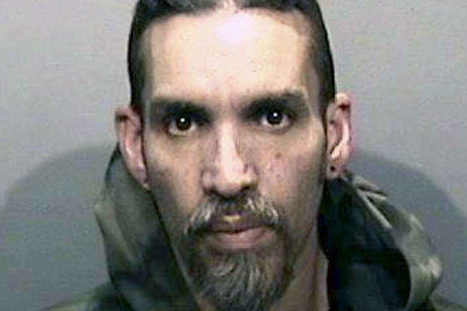 FILE - This Monday, June 5, 2017, file photo released by the Alameda County Sheriff's Office shows Derick Almena at Santa Rita Jail in Alameda County, Calif. Almena who was in charge of an artists' work-live warehouse that burned three years ago, killing 36, is due back in court Friday, Oct. 4, 2019, for a possible retrial. Almena's previous trial ended in a hung jury. (Alameda County Sheriff's Office via AP, File)