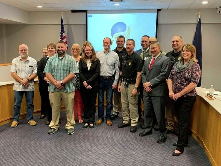 Recipients of the Midland County Board of Commissioner's Employee Appreciation Awards pose for a photo. (Mitchell Kukulka/Mitchell.Kukulka@mdn.net)