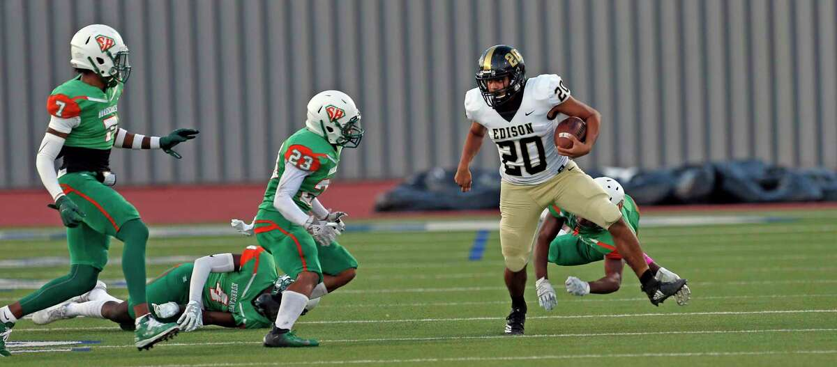 Edison running back Luke Converse avoids the tackle of a host of Sam Houston defenders in the first half of a 5A-1 Region IV District 13 football game between Sam Houston and Edison at Alamo Stadium on October 3, 2019.