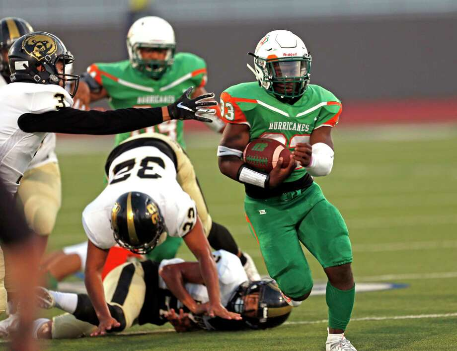 Sam Houston running back Darian Anderson leaves behind a host of Edison defenders in the first half of a 5A-1 Region IV District 13 football game between Sam Houston and Edison on Thursday at Alamo Stadium. Sam Houston won, 20-14. Photo: Ronald Cortes /Contributor / 2019 Ronald Cortes