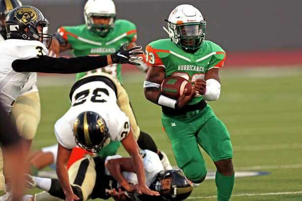 Sam Houston running back Darian Anderson leaves behind a host of Edison defenders in the first half of a 5A-1 Region IV District 13 football game between Sam Houston and Edison on Thursday at Alamo Stadium. Sam Houston won, 20-14.