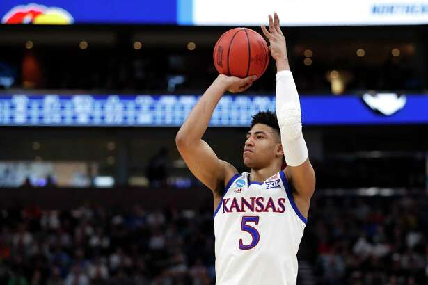 Kansas guard Quentin Grimes (5) shoots against Northeastern during a first round men's college basketball game in the NCAA Tournament Thursday, March 21, 2019, in Salt Lake City. (AP Photo/Jeff Swinger)