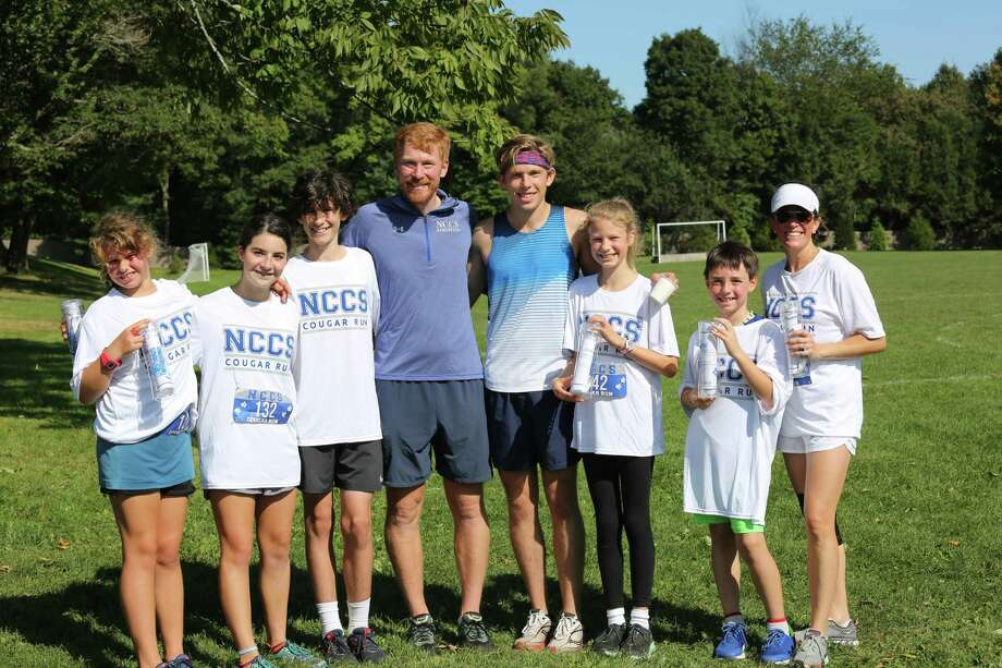 The winners of the 2019 New Canaan Country School Cougar Run 5K run are: Emma Stern of New Canaan (Lower School girl division); Daisy Fichthorn of Darien (Upper School girl division); Oliver Johnson of New Canaan (Upper School boy division); Head of School Aaron Cooper; James Randon, class of 2009 (Adult man division); Camilla Calderwood of Darien (Middle School girl division); Ben Kelsey of Darien (Lower School boy division); Erin Kanter of New Canaan (Adult woman division). Not pictured: Arthur Lilley of New Canaan (Middle School boy division). Photo: Contributed Photo.