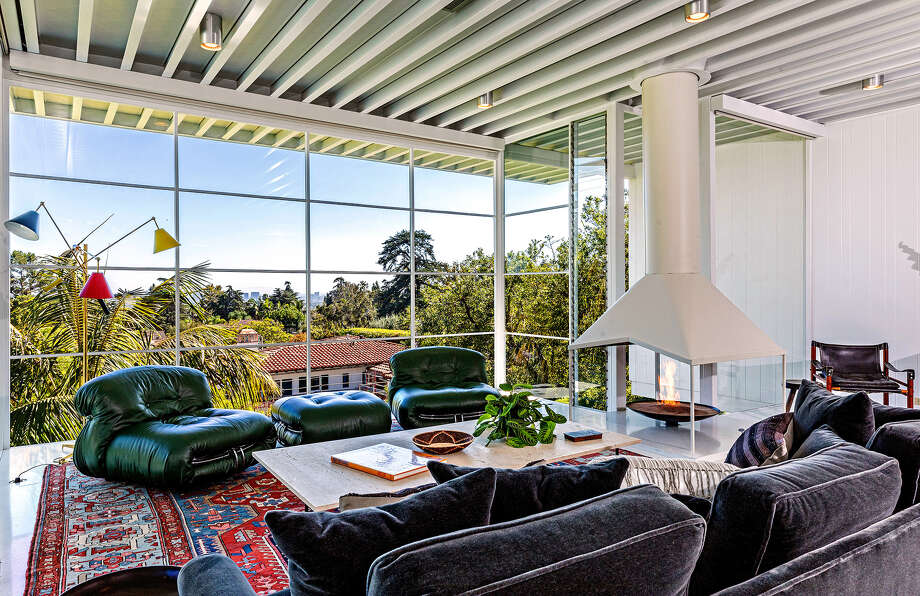 Maroon 5 guitarist James B. Valentine is seeking $3.785 million for a pristine Midcentury Modern-style home in Los Feliz. The striking residence, designed by Neil A. Johnson and built in 1960, was extensively restored by Mark Haddawy during Valentine's decade-plus of ownership. The single-story house features such modernist staples as terrazzo floors, beamed ceilings and walls of floor-to-ceiling windows. A suspended fireplace is an attention-grabber in the living room. The 2,100-square-foot house also has a garden-view dining room, an updated kitchen, three bedrooms and two bathrooms. (Simon Berlyn) Photo: Simon Berlyn / Los Angeles Times