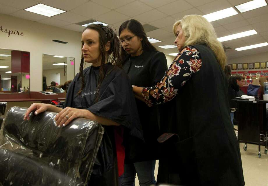 Cosmetology student Higinia Sanchez cuts the hair of Amy Duncan while teacher Sherryl Grey instructs as students with the Splendora ISD cosmetology gave free haircuts to victims of Tropical Depression Imelda at Splendora Junior High School, Thursday, Oct. 3, 2019, in Splendora. Duncan, who lives in the Splendora Lakes subdivision, said her home received between a foot and two feet of water from Tropical Depression Imelda. Photo: Jason Fochtman, Houston Chronicle / Staff Photographer / Houston Chronicle