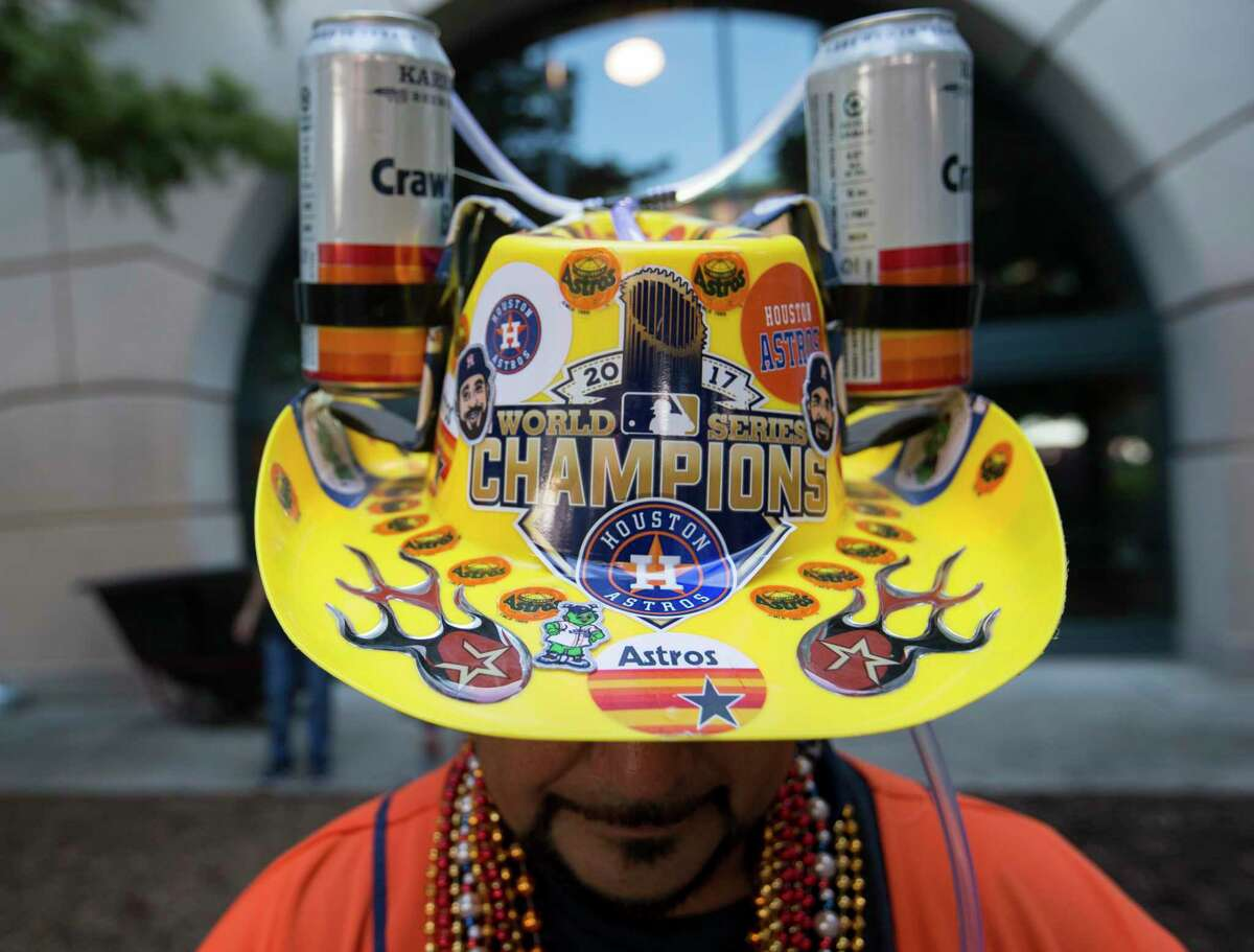 Houston Astros fan Daniel Flores wears an Astros beer hat to participate the fan fest before the ALDS Game 1 against the Tampa Bay Rays at Minute Maid Park on Friday, Oct. 4, 2019, in Houston.