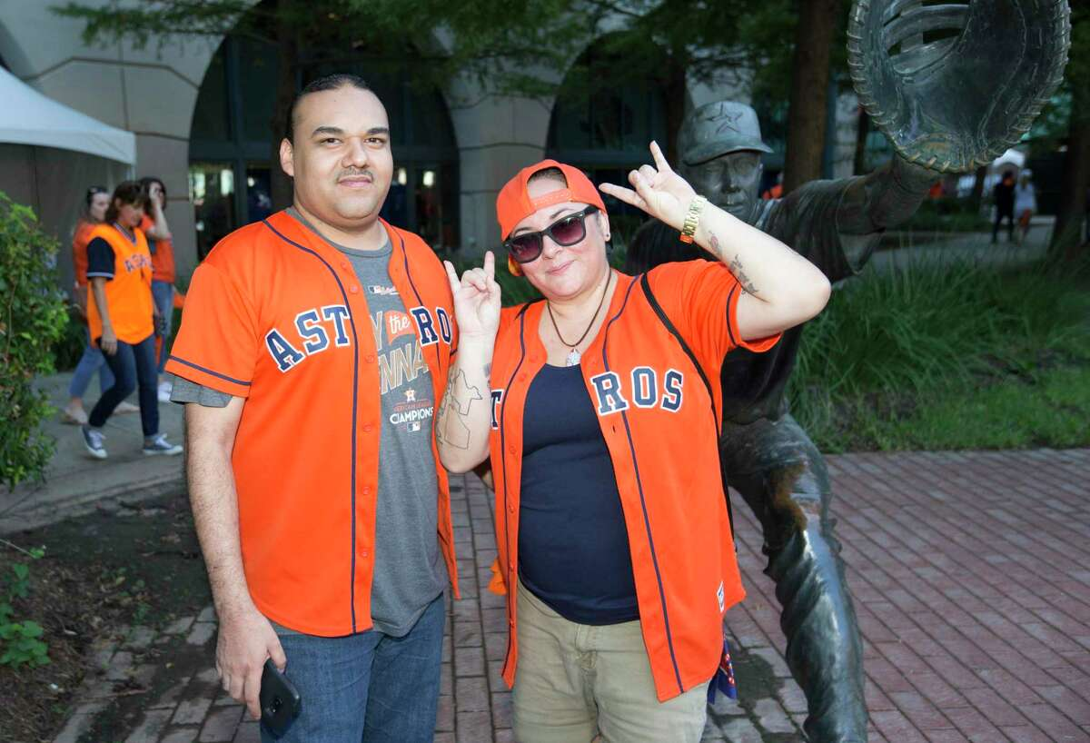 Houston Astros fans pose for a photograph before the ALDS Game 1 against the Tampa Bay Rays at Minute Maid Park on Friday, Oct. 4, 2019, in Houston.