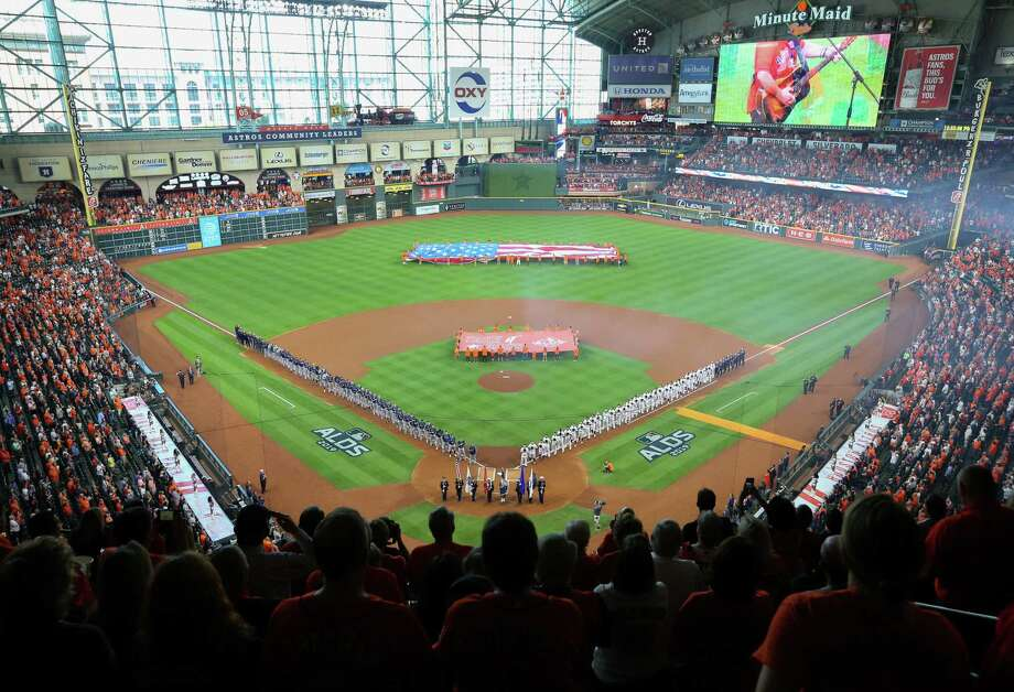 PHOTOS: A look at the Astros' pregame festivities before Game 1 on Friday AnAmerican flag is presented during the pre-game ceremony before the ALDS Series Game 1 between the Houston Astros and Tampa Bay Rays at Minute Maid Park on Friday, Oct. 4, in Houston. Photo: Yi-Chin Lee, Staff Photographer / Houston Chronicle