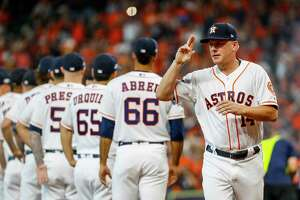 Houston Astros manager AJ Hinch (14) is introduced before Game 1 of the American League Division Series at Minute Maid Park on Friday, Oct. 4, 2019, in Houston.