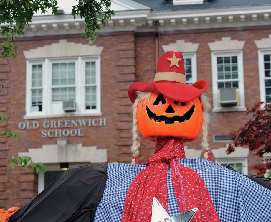 A pumpkin-head cowgirl can be seen in front of the Old Greenwich School the Old Greenwich section of Greenwich in 2016. The Old Greenwich School annual Pumpkin Patch, the school's largest fundraising event of the year, returns October 19. Photo: Bob Luckey Jr. / Hearst Connecticut Media File Photo / Greenwich Time