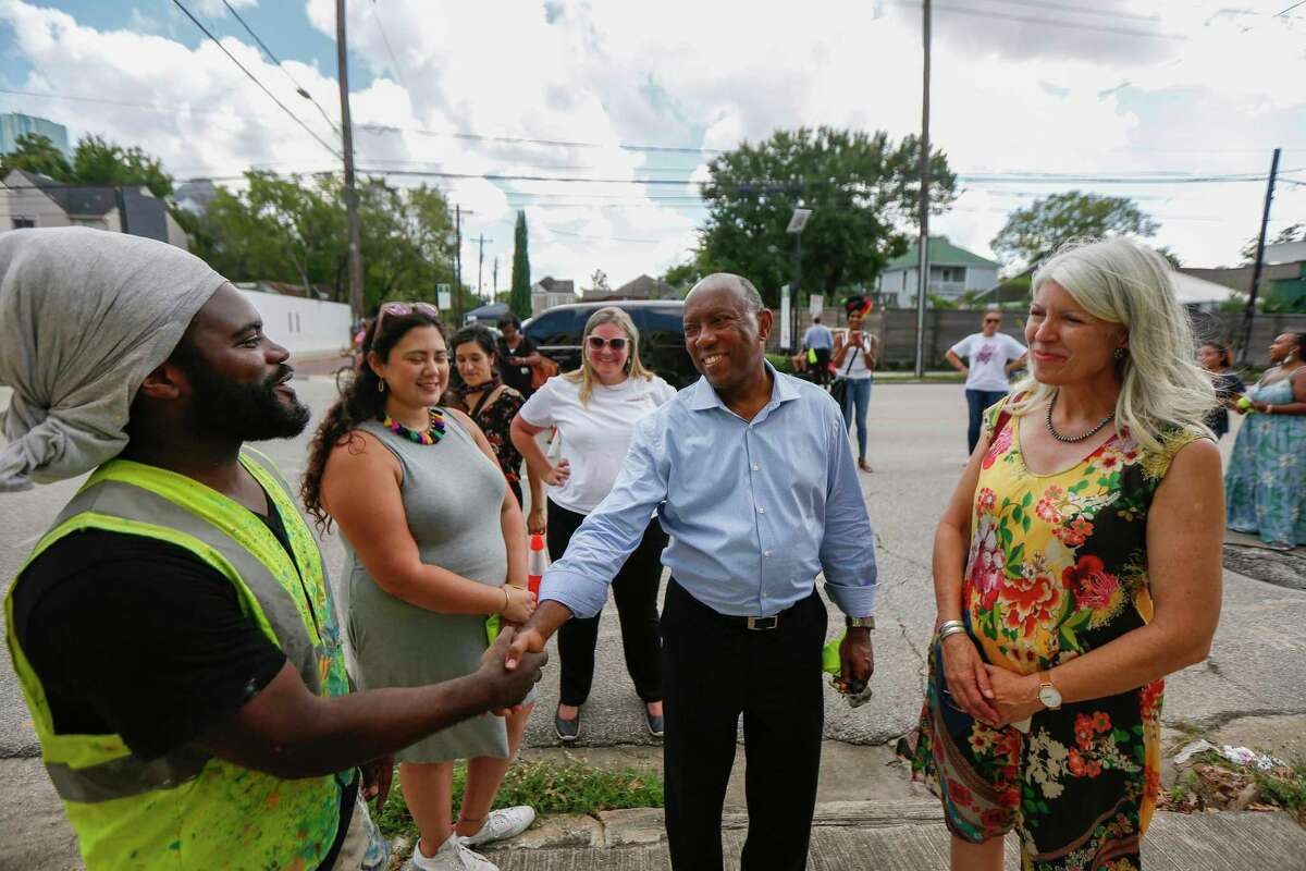 Mayor Sylvester Turner chats with artist Alex Aruz during the Cigna Sunday Streets Houston on Washington Ave. Sunday, Sept. 29, 2019, in Houston. Cigna Sunday Streets Houston is an initiative to promote and improve the health of Houstonians.