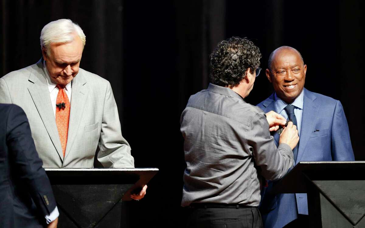 Houston Mayor Sylvester Turner gets his microphone turned on before a debate at the Hobby Center on Wednesday, Oct. 2, 2019. Along with Turner, the debate included Dwight Boykins, Tony Buzbee, Bill King, and Sue Lovell.