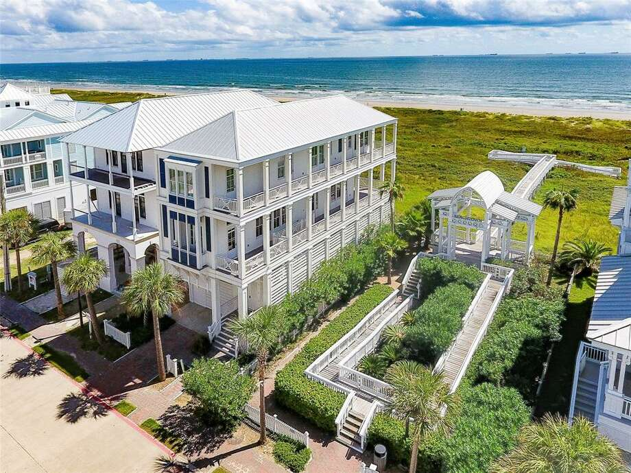 Located at 1625 Seaside Drive, this dreamy Galveston mansion just hit the market for $1.9 million. The beachfront estate boasts three bedrooms, three and half bathrooms, a heated pool located underneath the home, upper level Azek porch decking with direct access from every room, an elevator and more. Photo: Houston Association Of Realtors