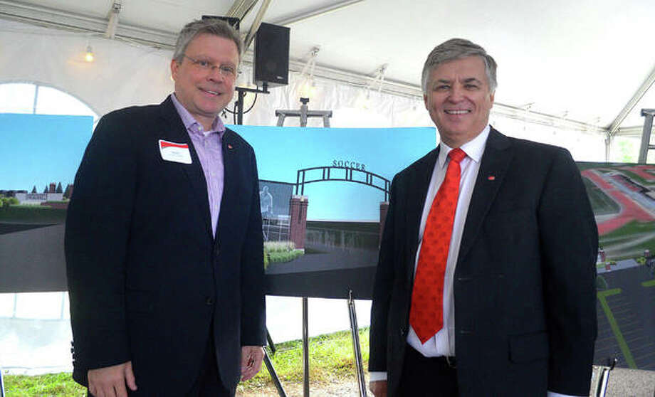 SIUE athletic director Tim Hall and chancellor Randy Pembrook stand in a front of series of storyboards displaying planned improvements at Ralph Korte Stadium during Thursday's SIUE Day Networking Breakfast, which was held at the stadium parking lot. Photo: Scott Marion | For The Telegraph