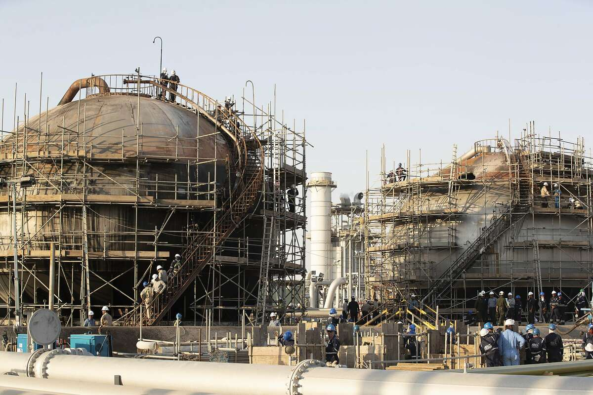 Workers repair damaged tanks at Saudi Aramco's Abqaiq crude oil processing plant following a drone attack in Abqaiq, Saudi Arabia, on Friday, Sept. 20, 2019. Saudi Aramcorevealed the significant damage caused by an aerial strike on its Khurais oil field and Abqaiq crude-processing plant last weekend, and insisted that the sites will be back to pre-attack output levels by the end of the month. Photographer: Faisal Al Nasser/Bloomberg