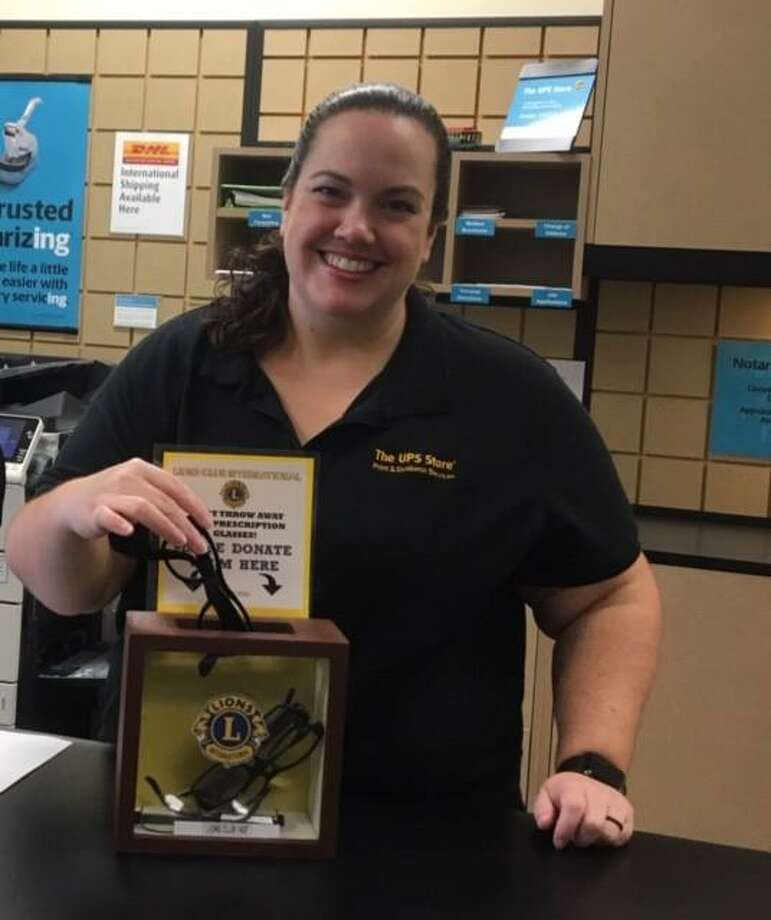 Trina Turpin of the UPS Store in Willis proudly displays her new eyeglass collection box from the Panorama Lions Club. Photo: Courtesy Photo