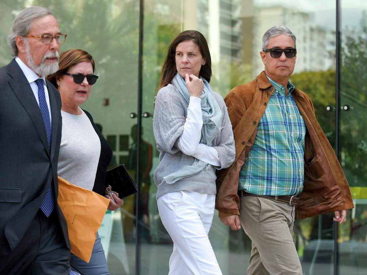 Michelle Troconis, center, along with her attorney Andrew Bowman, left, leave Stamford Superior Court following a brief appearance on Oct. 4, 2019 in Stamford, Connecticut.