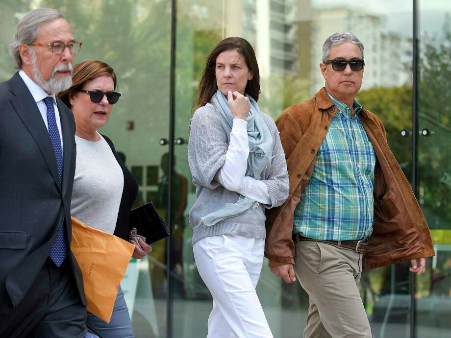Michelle Troconis, center, along with her attorney Andrew Bowman, left, leave Stamford Superior Court following a brief appearance on Oct. 4, 2019 in Stamford, Connecticut. Photo: Matthew Brown / Hearst Connecticut Media / Stamford Advocate