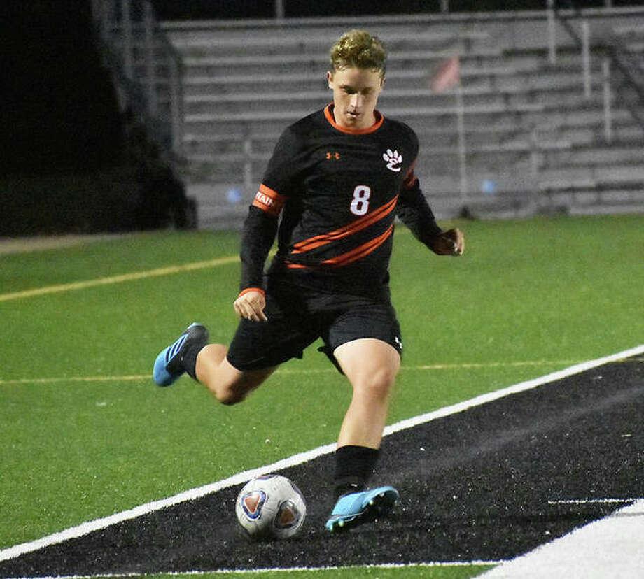 Edwardsville's Kurt Wright takes a free kick in the second half against Belleville West on Thursday in Edwardsville. Photo: Matt Kamp|The Intelligencer