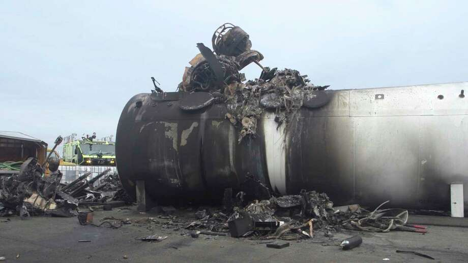 This image taken from video provided by National Transportation Safety Board shows damage from a World War II-era B-17 bomber plane that crashed Wednesday at Bradley International Airport, Thursday, Oct. 3, in Windsor Locks. The plane crashed and burned after experiencing mechanical trouble on takeoff. Photo: Associated Press / National Transportation Safety Board