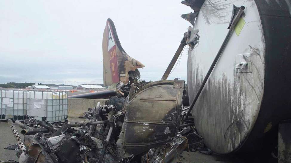 This image taken from video provided by National Transportation Safety Board shows damage from a World War II-era B-17 bomber plane that crashed Wednesday at Bradley International Airport, Thursday, Oct. 3, 2019 in Windsor Locks, Conn. The plane crashed and burned after experiencing mechanical trouble on takeoff Wednesday morning from Bradley International Airport. (NTSB via AP)