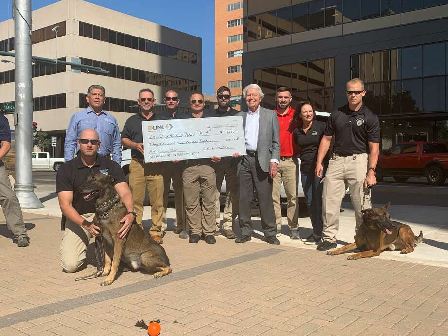 Bulletproof vests were presented to the Midland Police Department's K-9 unit in a ceremony Thursday at the downtown Bank of America plaza. Photo: Courtesy Photo