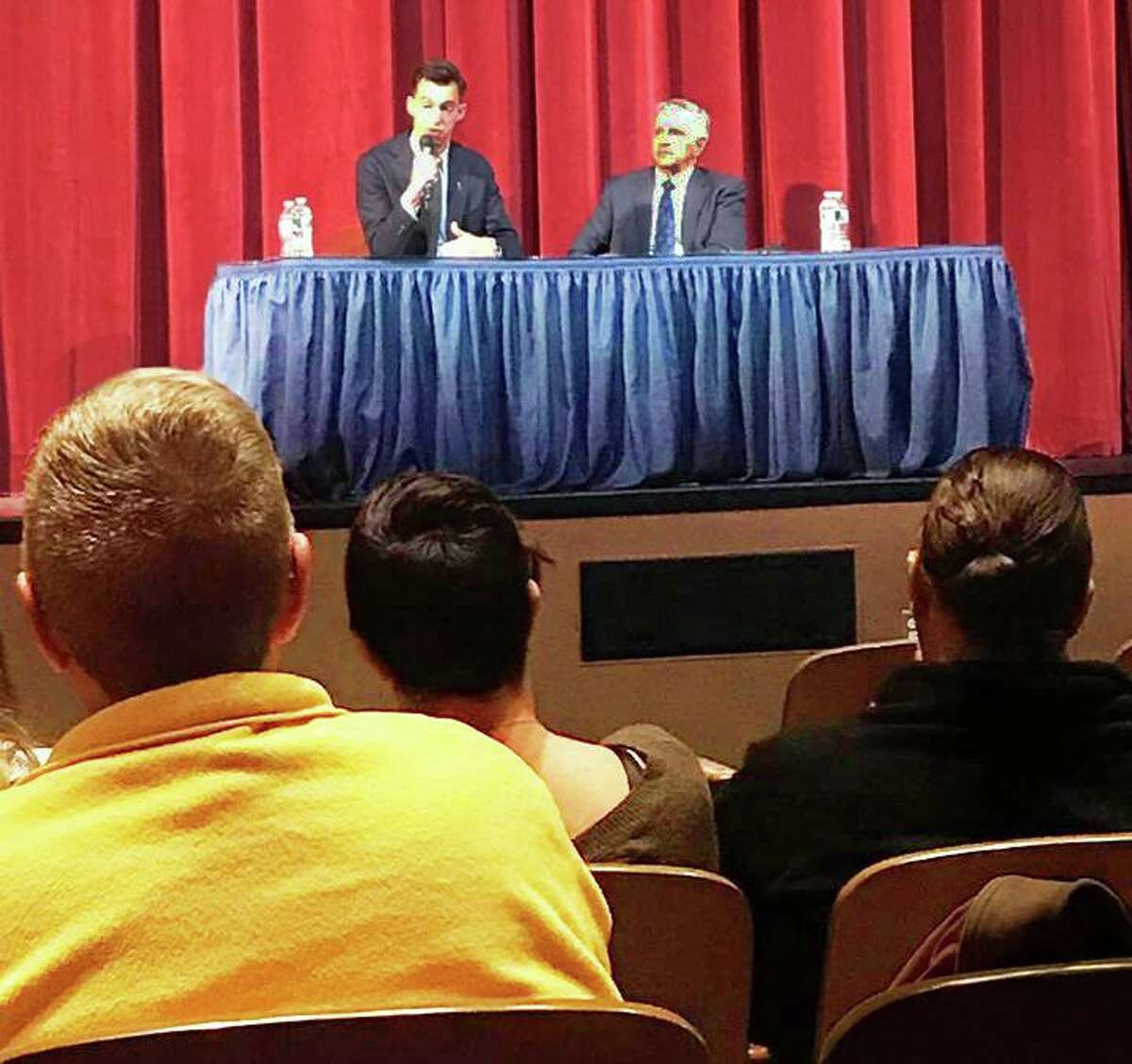 Mayoral candidates Ben Florsheim, left, and Middletown Council Minority Leader Sebastian N. Giuliano, right answer questions during an election forum at Middletown High School.