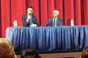 From left, Democrat Ben Florsheim and Middletown Council Minority Leader, Republican Sebastian N. Giuliano, both candidates for mayor in November, answer questions from the moderator during a forum organized by the Middletown Federation of Teachers, Middletown Ministeral Alliance and Middletown NAACP at Middletown High School Thursday evening.