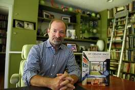 Architect Donald Rattner, seen here in his Greenwich home, wrote about creating creative spaces.