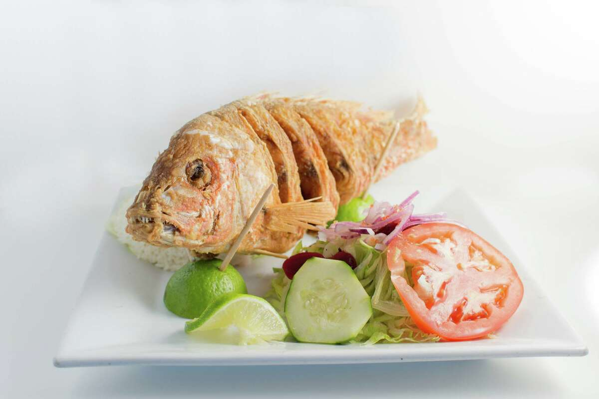 Entero Frito, a whole-fried fish, might look intimidating but is filled with flavor at Fiesta Limena.