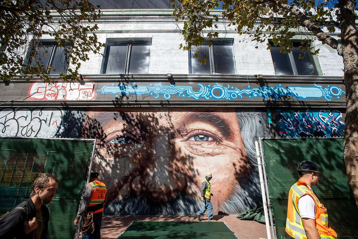A construction worker installs fencing at 1028 Market St. on Thursday, Oct. 3, 2019, in San Francisco. The long vacant property, which previously housed Hollywood Billiards, will become a 186 unit housing development.