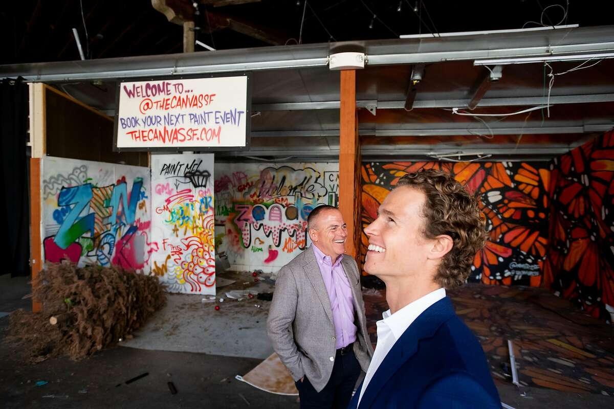 Developers Craig Young, right, and Dan Deibel stand inside 1028 Market St. on Thursday, Oct. 3, 2019, in San Francisco. The long vacant property, which previously housed Hollywood Billiards, will become a 186 unit housing development.
