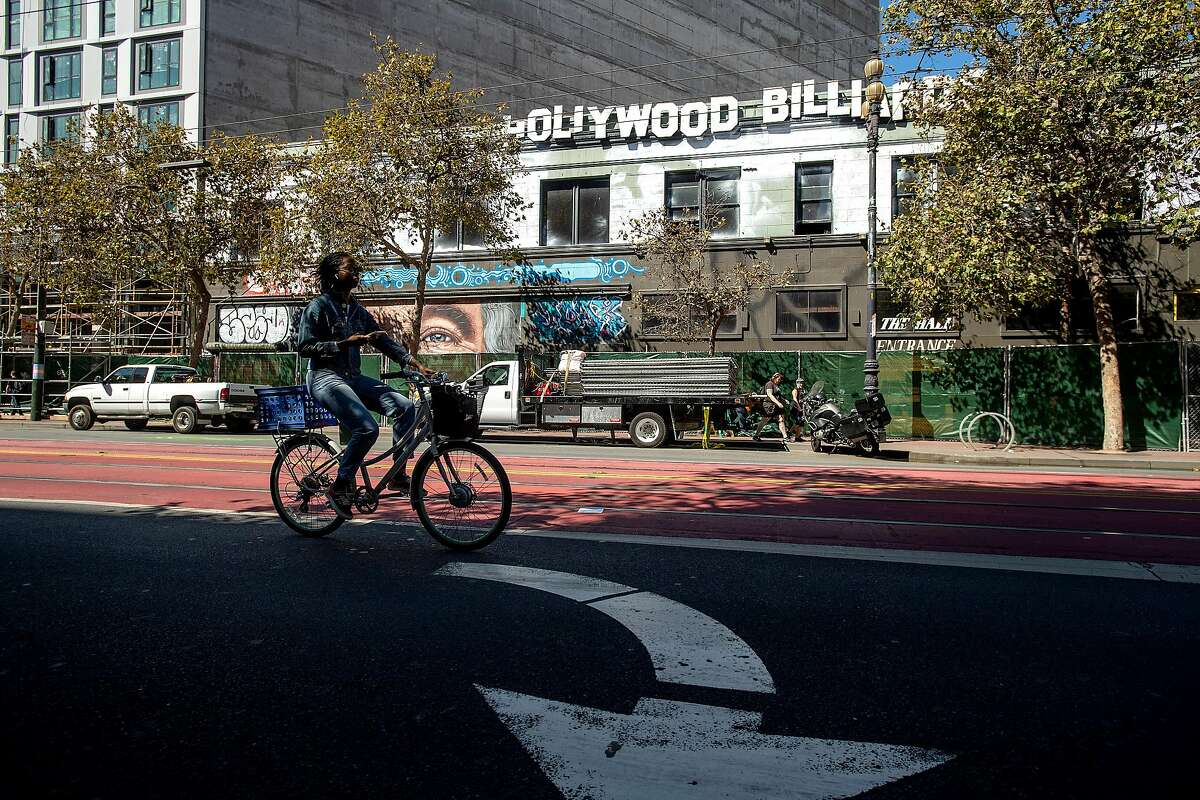 A biker passes 1028 Market St. on Thursday, Oct. 3, 2019, in San Francisco. The long vacant property, which previously housed Hollywood Billiards, will become a 186 unit housing development.