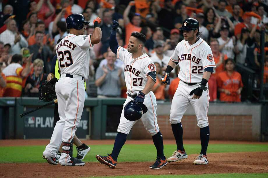 Houston Astros second baseman Jose Altuve (27) celebrates his two-run homer against the Tampa Bay Rays in the fifth inning during Game 1 of a best-of-five American League Division Series baseball game in Houston. Photo: Eric Christian Smith, FRE / Associated Press / FR171023 AP
