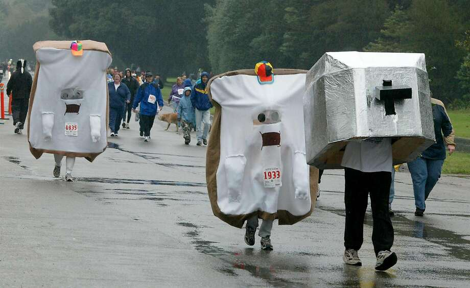 The 19th annual Run to The Far Side walk and run in rainy Golden Gate Park. More than 10,000 people assembled to pay tribute to the cartoon creations of Gary Larson in his strip The Far Side. Photo: Brant Ward / The Chronicle