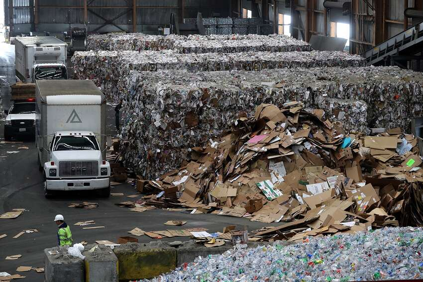 A wall of baled paper stands behind piled cardboard at Recology's Recycle Central in San Francisco in this 2018 file photo. Despite the declining global market for recyclable plastic and paper, Recology and San Francisco are continuing to push recycling even as other cities are rolling back or shutting down their programs. So it's more important than ever to know what can and cannot be recycled in the city. Here are some items that can cause confusion.