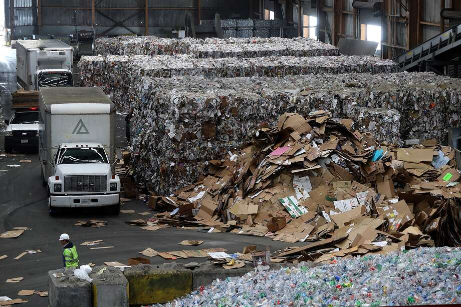 A wall of baled paper stands behind piled cardboard at Recology's Recycle Central in San Francisco in this 2018 file photo. Despite the declining global market for recyclable plastic and paper, Recology and San Francisco are continuing to push recycling even as other cities are rolling back or shutting down their programs. So it's more important than ever to know what can and cannot be recycled in the city. Here are some items that can cause confusion. Photo: Justin Sullivan/Getty Images / 2018 Getty Images